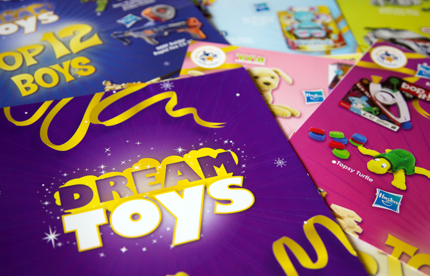 Close up photo of Dream Toys brochures and posters