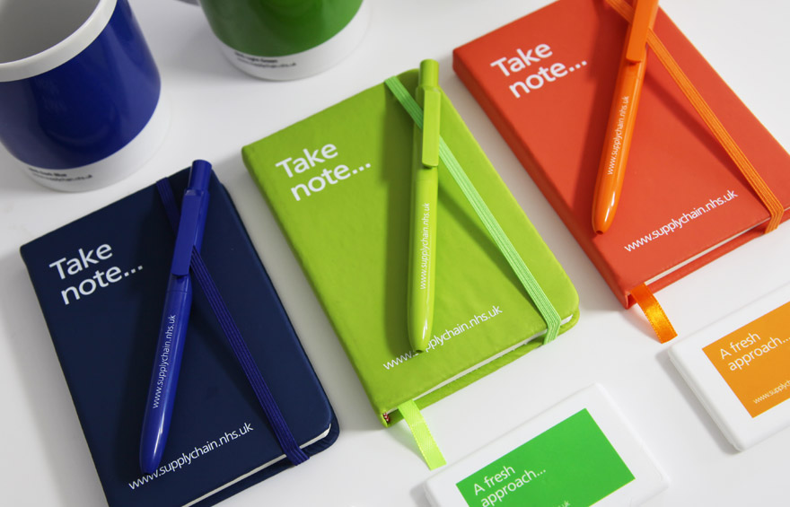 Branding across note pads, pens and mugs